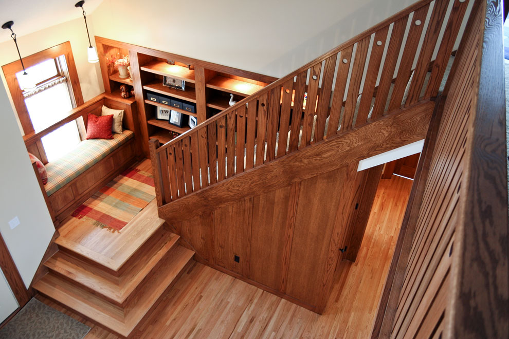 craftsman main staircase with built-in bench