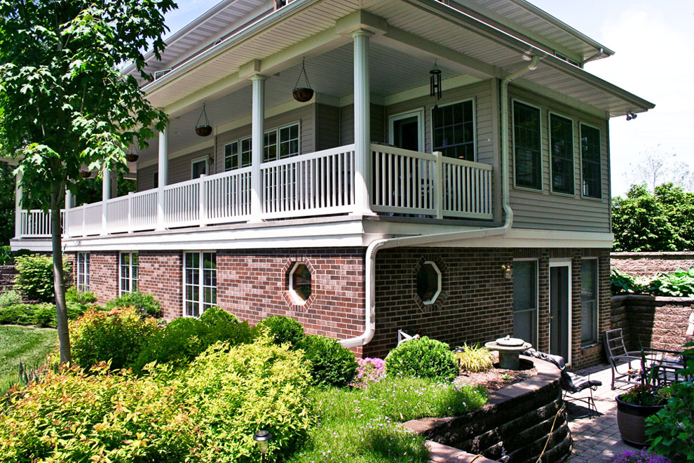 side exterior view with wrap around porch