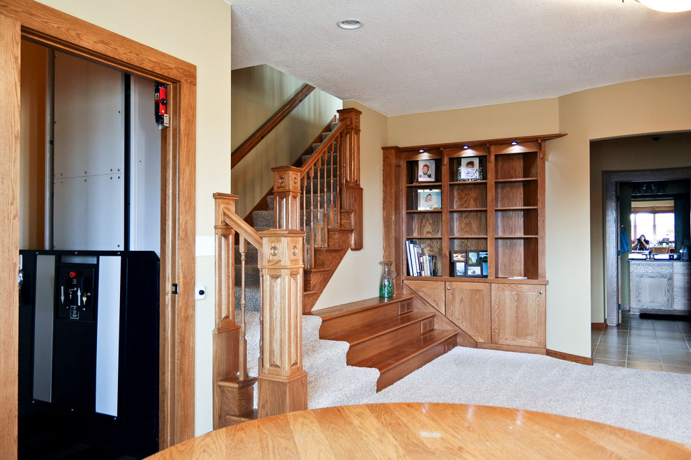 craftsman basement with built-ins and lift