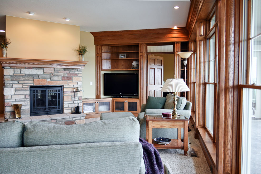 craftsman living room with stone fireplace view 2