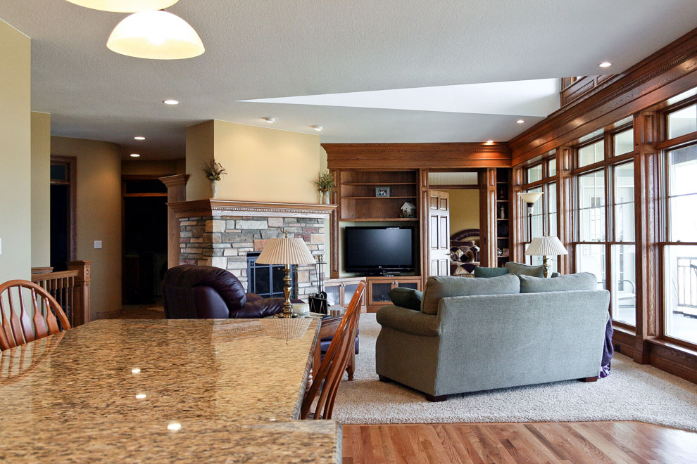craftsman living room with stone fireplace