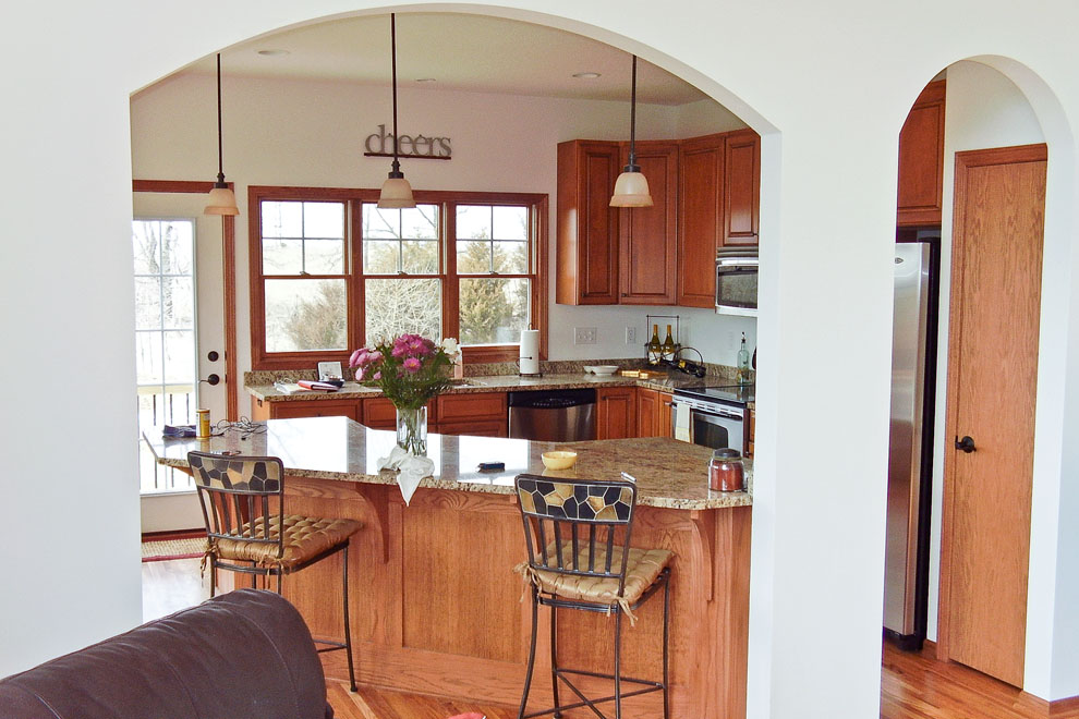 Traditional Custom Kitchen View Through Arched Wall