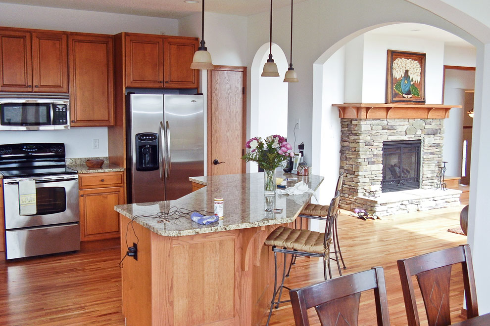 Craftsman Kitchen and Living Room View with Stone Fireplace