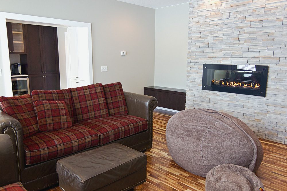 Contemporary Living Room With Stone Fireplace